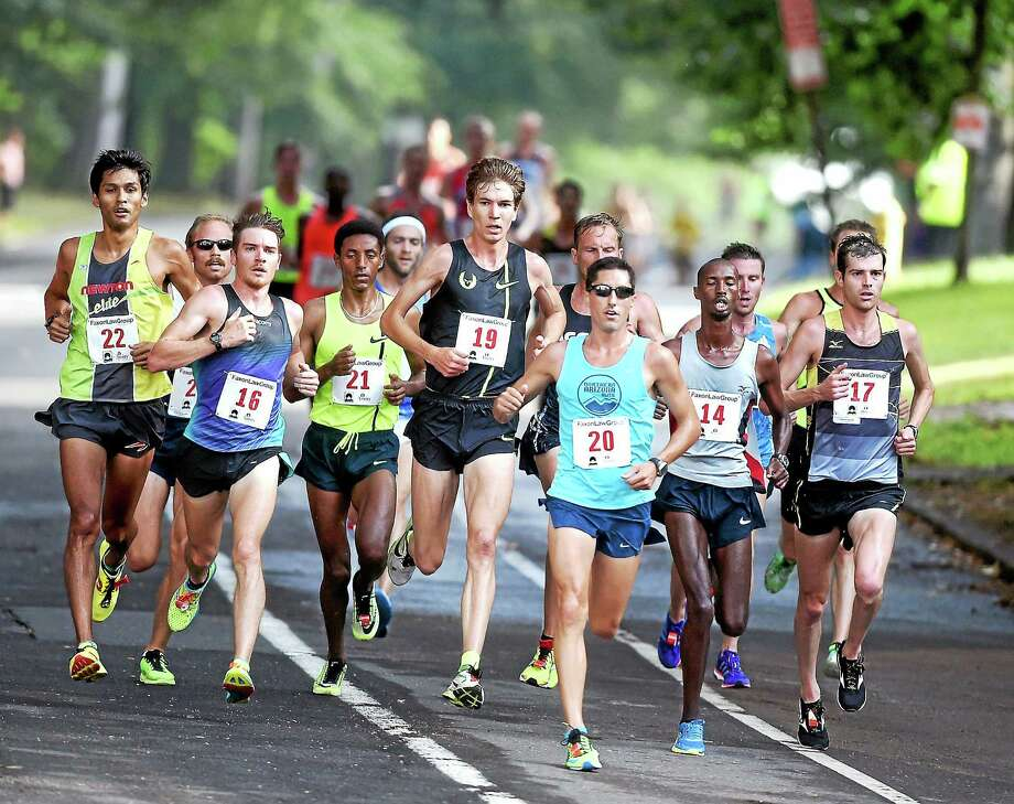 (Arnold Gold-New Haven Register)  The lead pack of runners come down Ella Grasso Blvd. in the 37th Annual Faxon Law New Haven Road Race on 9/1/2014. Photo: Journal Register Co.