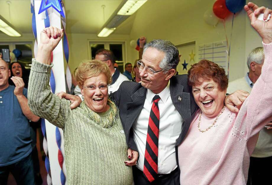 (Arnold Gold-New Haven Register)  East Haven Town Council Judy Esposito (left) and volunteer Carol Scussel (right) celebrate with East Haven Mayor Joseph Maturo, Jr., after election results are announced at campaign headquarters in East Haven on 11/3/2015.  Esposito and Maturo were reelected. Photo: Journal Register Co.