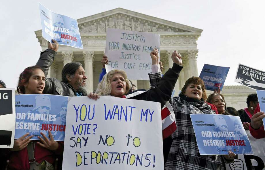 """Members of CASA de Maryland participate in a immigration rally outside the Supreme Court in Washington, Friday, Jan. 15, 2016. The Supreme Court has agreed to an election year review of President Barack Obama's plan to allow up to 5 million immigrants to """"come out of the shadows"""" and work legally in the U.S. Photo: AP Photo/Susan Walsh    / AP"""