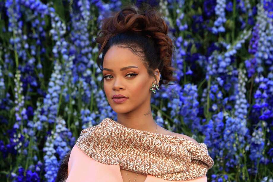 In this Oct. 2, 2015 photo, singer Rihanna poses before Christian Dior's Spring-Summer 2016 ready-to-wear fashion collection to be presented during the Paris Fashion Week, in Paris. Rihanna has released her much anticipated new album through Jay Zís Tidal streaming service, which she co-owns. Photo: AP Photo/Thibault Camus, File   / AP