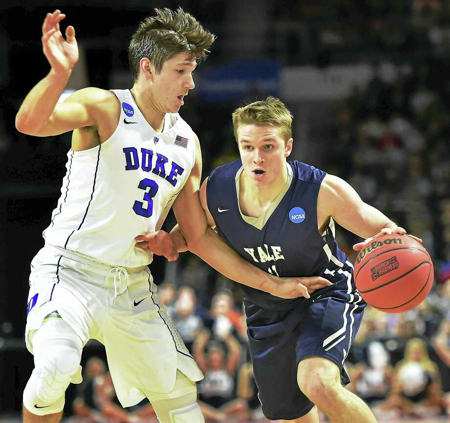 Yale sophomore guard Makai Mason moves the ball to the paint as Duke's Grayson Allen in the first half as the Blue Devils lead 48-25, Saturday, March 19, 2016, in the second round of the 2016 NCAA Men's Basketball Tournament at the Dunkin' Donuts Center in Providence, RI.  (Catherine Avalone/New Haven Register) Photo: Journal Register Co. / New Haven RegisterThe Middletown Press