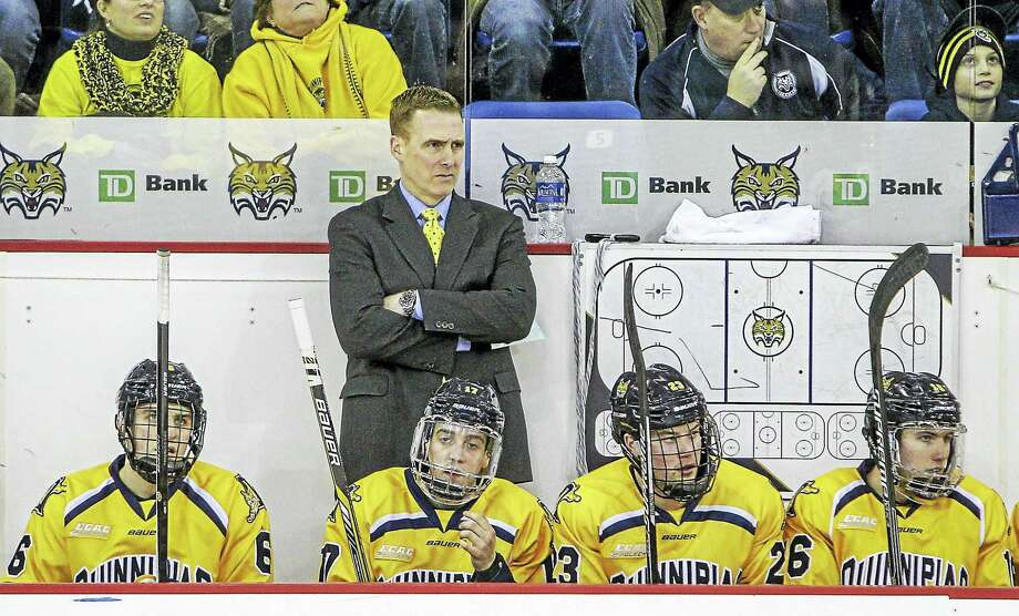 Action from Yale vs. Quinnipiac men's hockey at the Highpoint Arena at Quinnipiac University. The Bulldogs and Bobcats battled to a 2-2 tie Friday night. Photo: Journal Register Co. / COPYRIGHTED