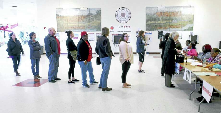 People stand in line to vote at Wilbur Cross High School in New Haven Tuesday, April 26, 2016. Photo: Arnold Gold — New Haven Register