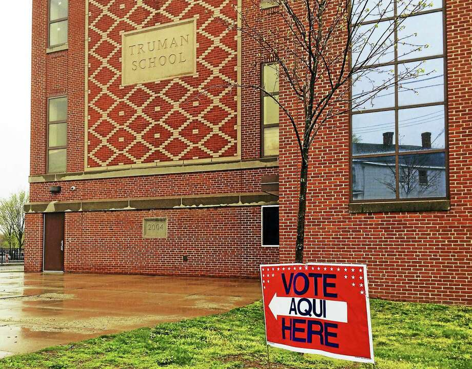 Wes Duplantier/The New Haven RegisterThousands of voters across Greater New Haven and around Connecticut braved the rain Tuesday to cast their ballots in the state's presidential primaries at places like the Truman School in New Haven. Photo: Journal Register Co.