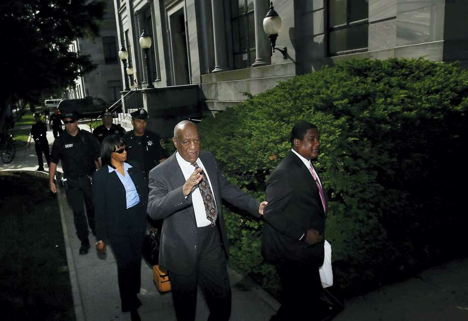 Bill Cosby waves to the media as he arrives at the Montgomery County Courthouse for a preliminary hearing on May 24, 2016, in Norristown, Pa. Cosby is accused of drugging and molesting a woman at his home in 2004. Photo: AP Photo — Matt Slocum    / Copyright 2016 The Associated Press. All rights reserved. This material may not be published, broadcast, rewritten or redistribu