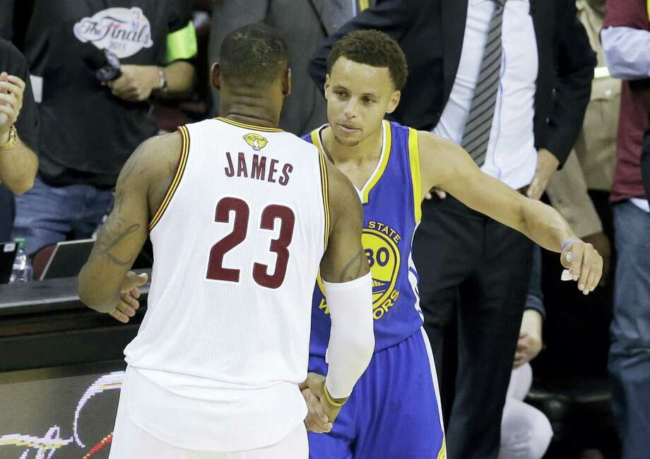 FILE - In this June 16, 2015, file photo, Cleveland Cavaliers forward LeBron James (23) hugs Golden State Warriors guard Stephen Curry (30) during the second half of Game 6 of basketball's NBA Finals in Cleveland. The Bay Area will be the center of the sports world this weekend when it plays host to both the NBA Finals and the Stanley Cup Final. (AP Photo/Darron Cummings, File) Photo: AP / Copyright 2016 The Associated Press. All rights reserved. This material may not be published, broadcast, rewritten or redistribu
