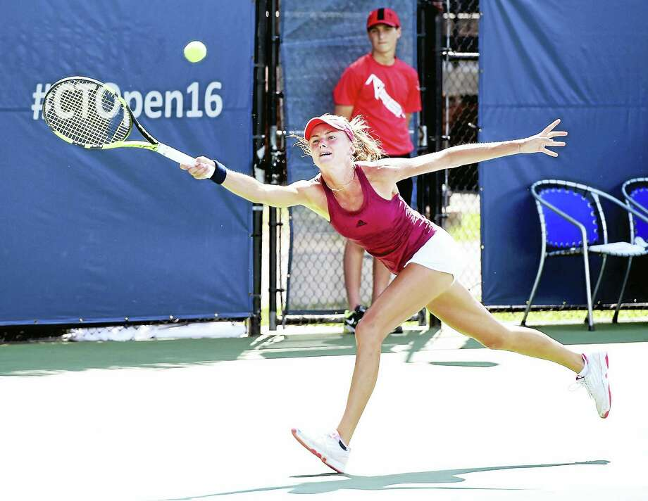Daniela Hantuchova stretches for a shot against Kirsten Flipkens during a qualifying match on Friday. Photo: Arnold Gold — Register