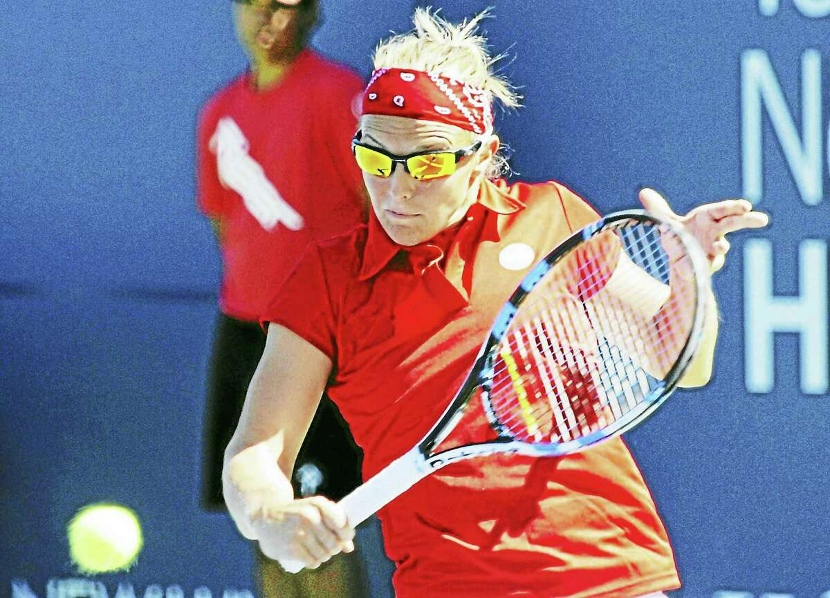 Kirsten Flipkens makes a volley during her three-set victory over Belinda Bencic at the Connecticut Open. BOB CHILD — FOR THE REGISTER