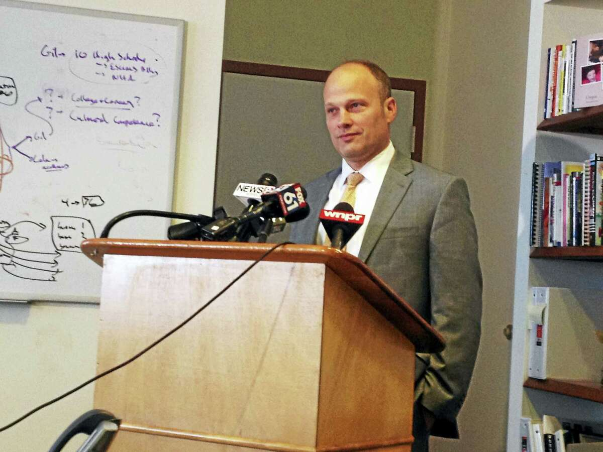 New Haven Superintendent of Schools Garth Harries speaks during a press conference on Tuesday, announcing an early end to his contract, effective Nov. 1, 2016.