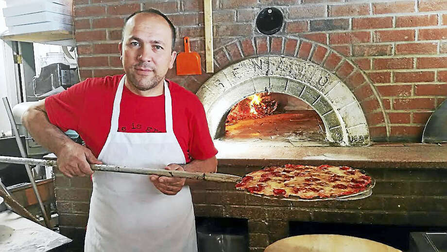 Pizza at the Brick Oven owner Kadir Catalbasoglu prepare special pizza for viewers Thursday. Photo: Digital First Media