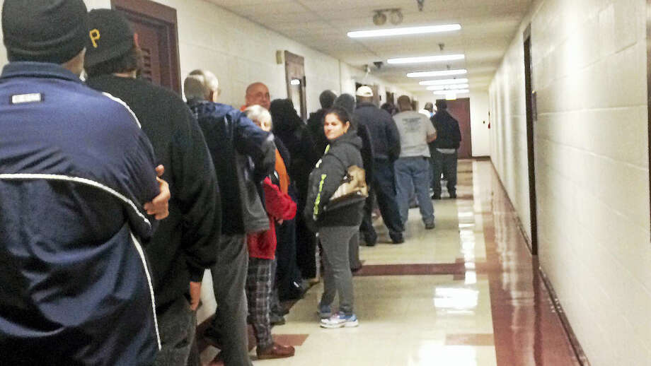 Wes Duplantier — New Haven Register  Dozens of people line up early to vote at West Haven City Hall on Tuesday, Nov. 8, 2016. Photo: Digital First Media