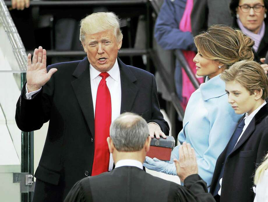 Donald Trump is sworn in as the 45th president of the United States by Chief Justice John Roberts as Melania Trump looks on during the 58th Presidential Inauguration at the U.S. Capitol in Washington, Friday, Jan. 20, 2017. Photo: AP Photo/Matt Rourke    / Copyright 2017 The Associated Press. All rights reserved.