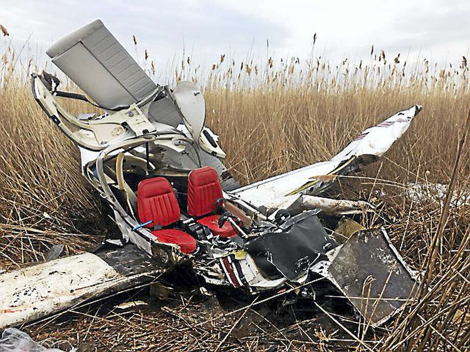 A crash involving a single engine plane near Tweed New Haven Regional Airport happened just before 10 a.m. Wednesday. One person died and one person was critically injured in the crash. Photo: Courtesy Photo
