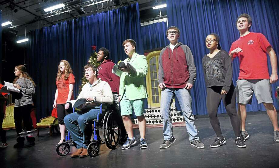 """Students in the West Haven High School Theatre Workshop rehearse the play """"Annie"""" in the school's auditorium recently. Photo: Arnold Gold — New Haven Register"""