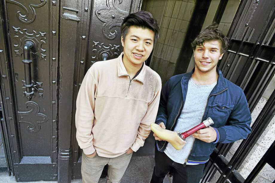 Yale juniors Victor Wang, of Hong Kong, co-founder of Penta, and team member Henry Iseman of New York, holding a prosthetic, run the non-profit organization that aims to provide used prosthetics to low-income Vietnamese living with amputations. Penta includes co-founder Trang Duong of Brown University and has been named this year's winner of the Yale College Dean's Challenge on Social Innovation. Photo: Catherine Avalone — New Haven Register / Catherine Avalone/New Haven Register