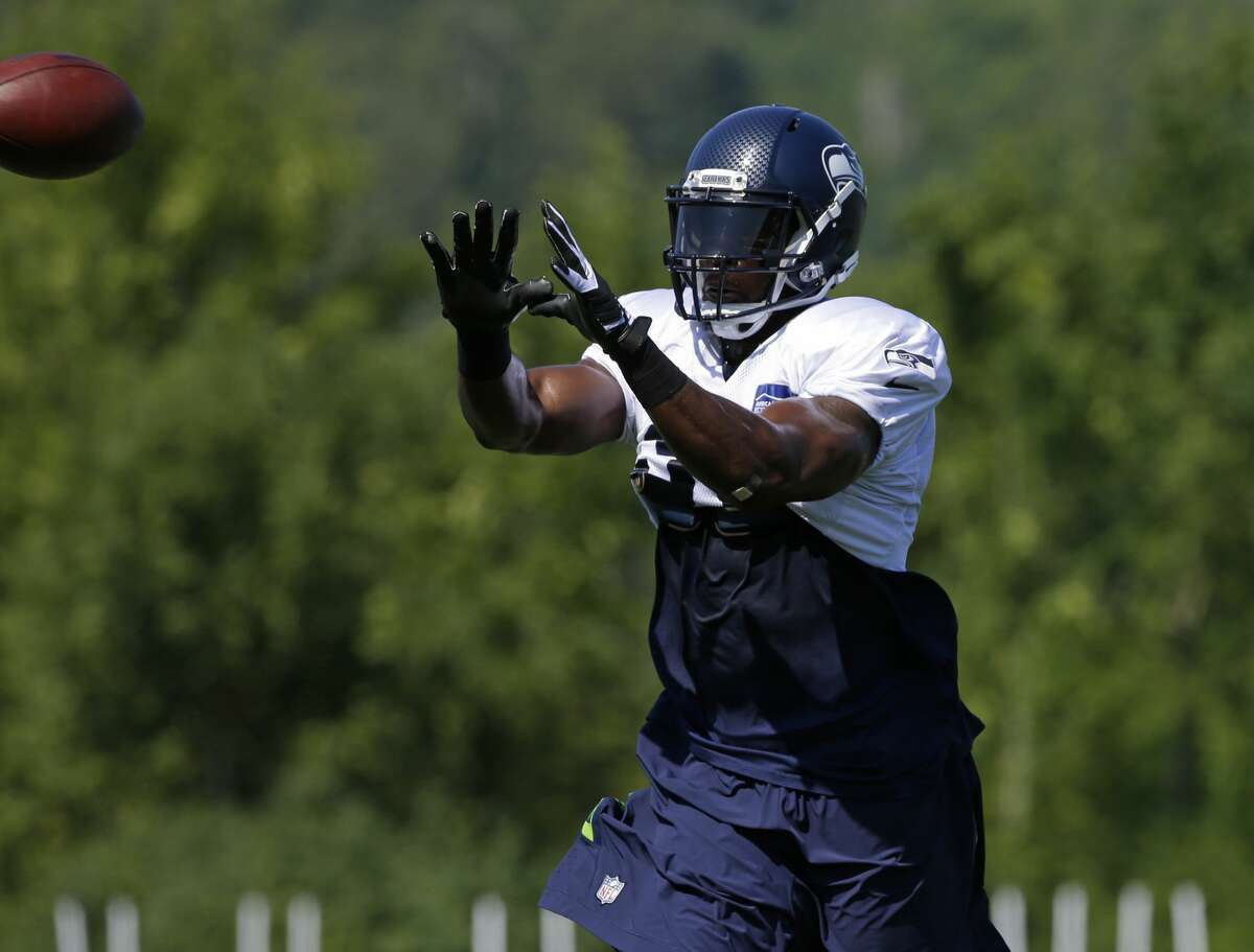 Seattle Seahawks strong safety Kam Chancellor catches the football during a drill at NFL football training camp, Tuesday, Aug. 1, 2017, in Renton, Wash. (AP Photo/Ted S. Warren)