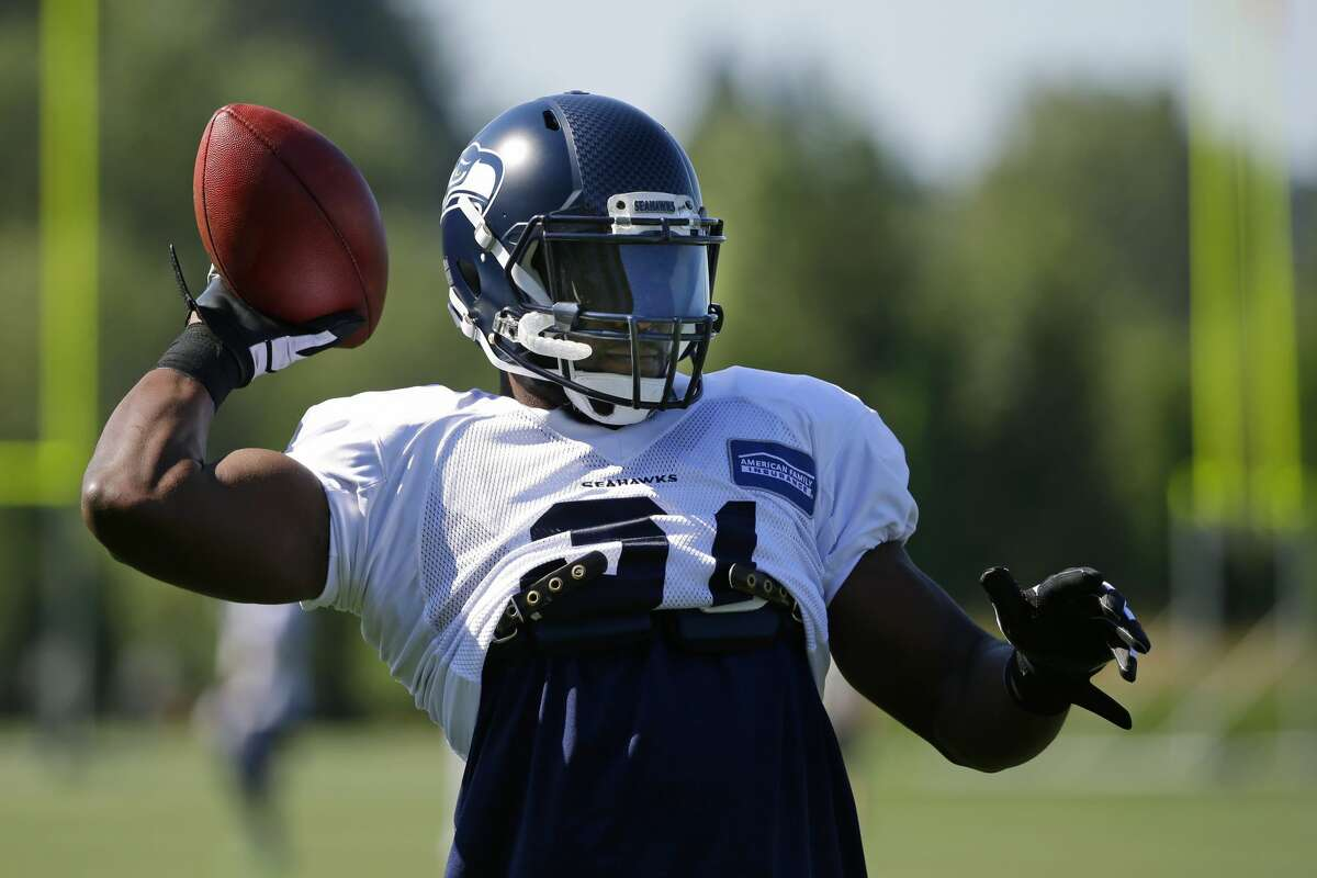 Seattle Seahawks strong safety Kam Chancellor passes the football while playing catch at the start of NFL football training camp, Tuesday, Aug. 1, 2017, in Renton, Wash. (AP Photo/Ted S. Warren)