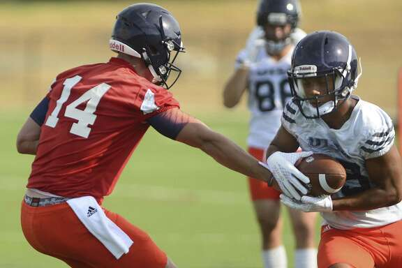 UTSA wide receiver Matt Guidry takes a handoff from quarterback Dalton Sturm during the first day of fall practice on Tuesday, Aug. 1, 2017.