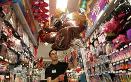 Kevin Cram a Party City employee made a Mylar bouquet for a Clint. San Francisco 49ers fans are stocking up on party supplies from new TV's to Mylar balloons. Thursday, Jan. 31, 2013 in San Francisco California.