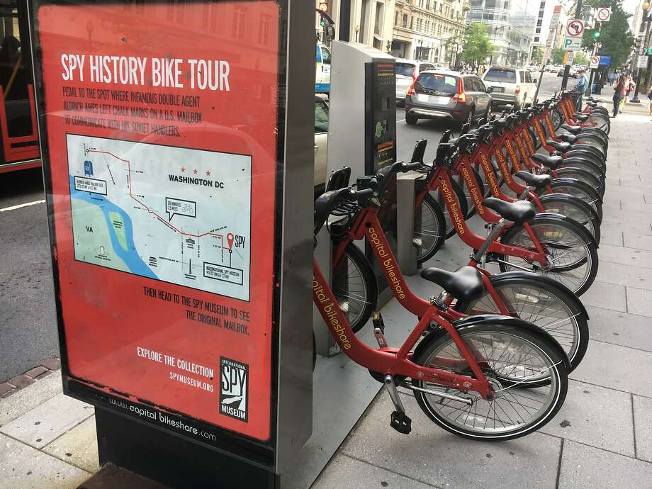 At one of the 440 Capital Bikeshare stations in Washington, a sign explains how to bike out to the famous mailbox site where CIA analyst-turned-KGB mole Aldrich Ames communicated with his Soviet handlers. Photo: Spud Hilton, The Chronicle