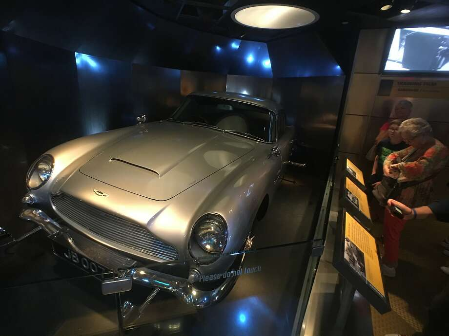 An Aston Martin DB5 — with modifications — like the one used in several James Bond films is among the popular displays at the International Spy Museum. Photo: Spud Hilton, The Chronicle