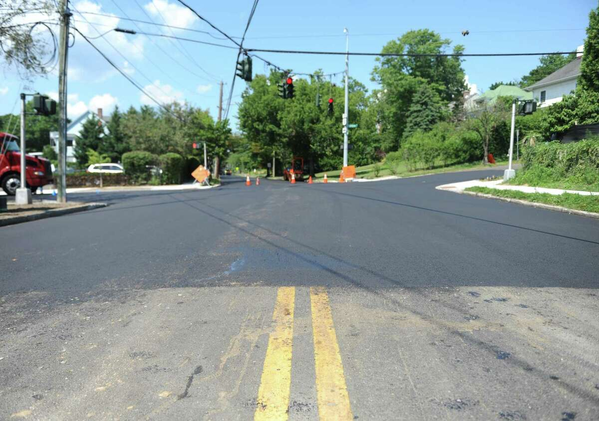 Fresh pavement is in place on a stretch of Milbank Avenue in Greenwich, Conn. Tuesday, Aug. 1, 2017. Re-paving work on along Milbank Avenue and Mason Street has caused recent road closures and the drainage project near the YMCA on East Putnam Avenue will restrict traffic to one lane in each direction beginning this week.