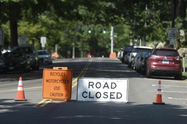 Milbank Avenue is closed as construction workers pave a stretch of the street in Greenwich, Conn. Tuesday, Aug. 1, 2017. Re-paving work on along Milbank Avenue and Mason Street has caused recent road closures and the drainage project near the YMCA on East Putnam Avenue will restrict traffic to one lane in each direction beginning this week.