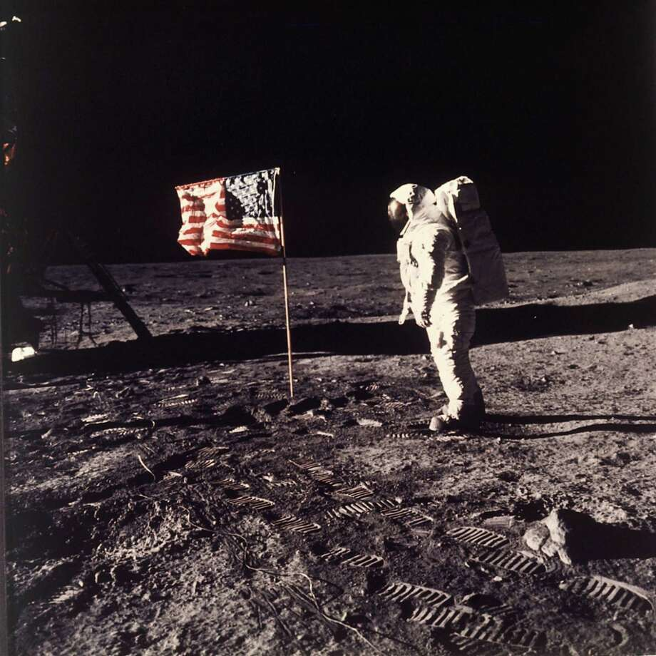 "Astronaut Edwin E. ""Buzz"" Aldrin Jr.  poses for a photograph beside the U.S. flag deployed on the moon during the Apollo 11 mission on July 20, 1969.  Aldrin and fellow astronaut Neil Armstrong were the first men to walk on the lunar surface with temperatures ranging from 243 degrees above to 279 degrees below zero.  Astronaut  Michael Collins flew the command module.  The trio was launched to the moon by a Saturn V launch vehicle at 9:32 a.m. EDT, July 16, 1969. They departed the moon July 21, 1969. Photo: NEIL A. ARMSTRONG, AP / 1969 AP"