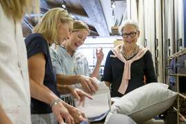From right: Design studio specialist Nancy Taylor helps out Victoria Bowen and her mother-in-law Kristen Bowen at the Pottery Barn on Tuesday, Aug. 1, 2017, in Corte Madera, Calif.