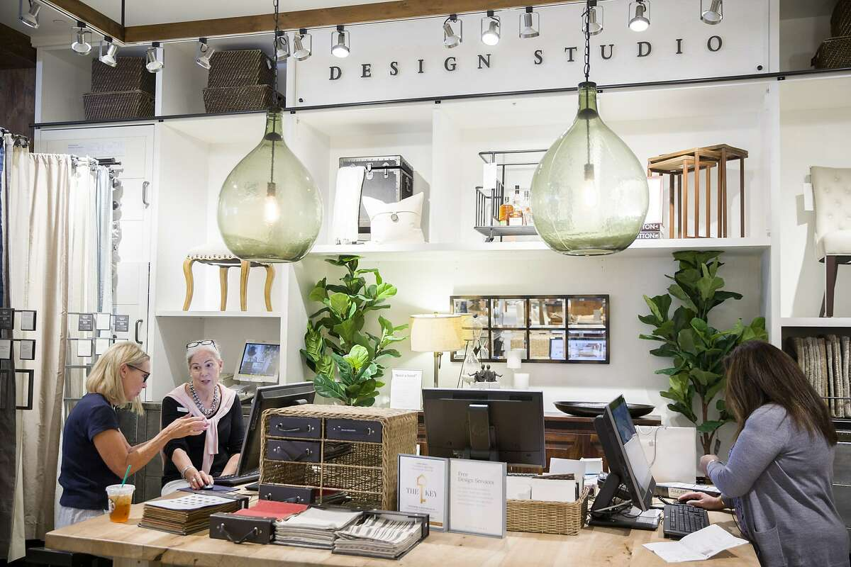 From left: Victoria Bowen is helped by design studio specialists Nancy Taylor and Aarati Kumar with different types of chairs at the Pottery Barn on Tuesday, Aug. 1, 2017, in Corte Madera, Calif.