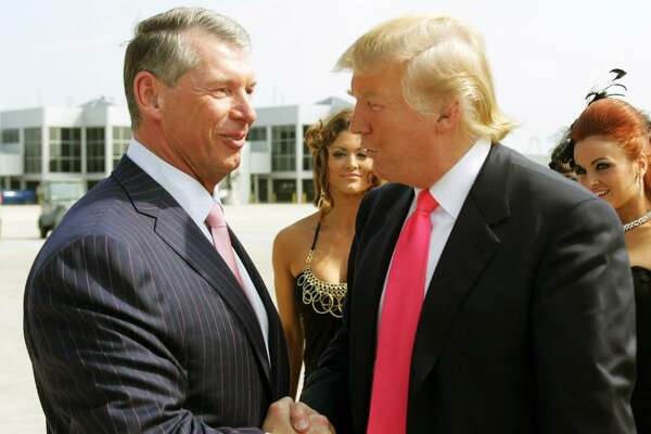 Vince McMahon (L) and Donald Trump attend a press conference about the WWE at the Austin Straubel International Airport on June 22, 2009 in Green Bay, Wisconsin.  (Photo by Mark A. Wallenfang/Getty Images)