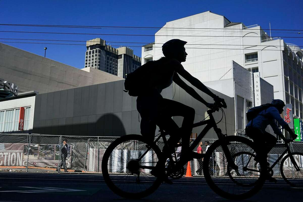 Cyclist make their way down Market Street in San Francisco, Calif. on Friday, Sept. 25, 2015. Mayor Ed Lee said he will veto legislation that would require police to make cyclists who don't stop at stop signs a low priority.