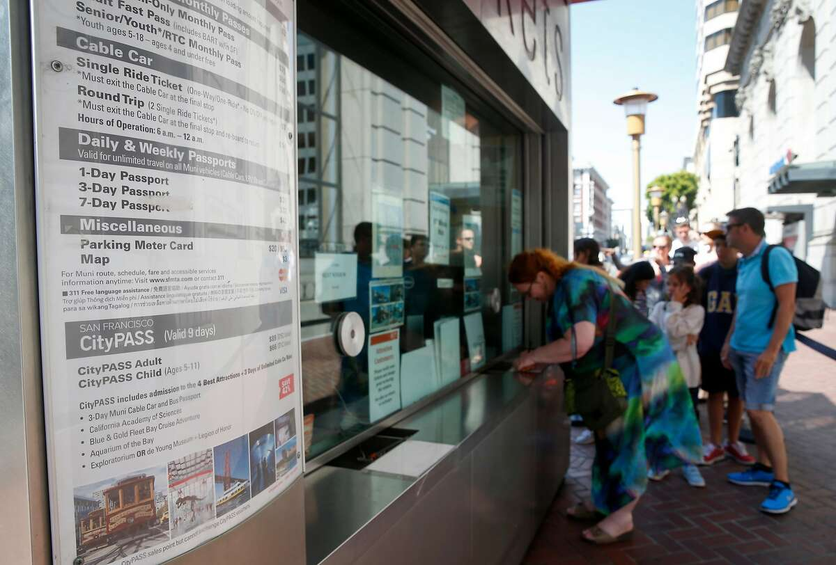 Passengers wait in line to purchase cable car tickets at a booth above Hallidie Plaza in San Francisco, Calif. on Tuesday, Aug. 1, 2017. A controller's report released this week found that many fares went uncollected by conductors from passengers wanting to pay with cash on board.