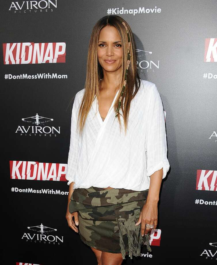 """Actress Halle Berry showed a little more than she probably planned at the premier of her new movie """"Kidnap,"""" when her comfortable, boho top meant to look like this... Photo: Jason LaVeris/FilmMagic"""