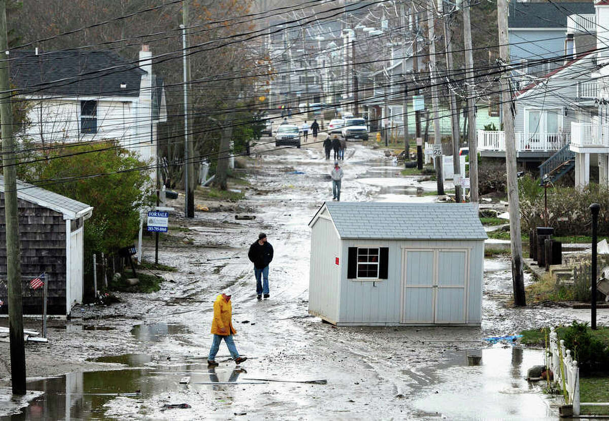 A shed lies in the middle of a sand covered Melba St. in Milford on 10/30/2012. Photo by Arnold Gold/New Haven Register