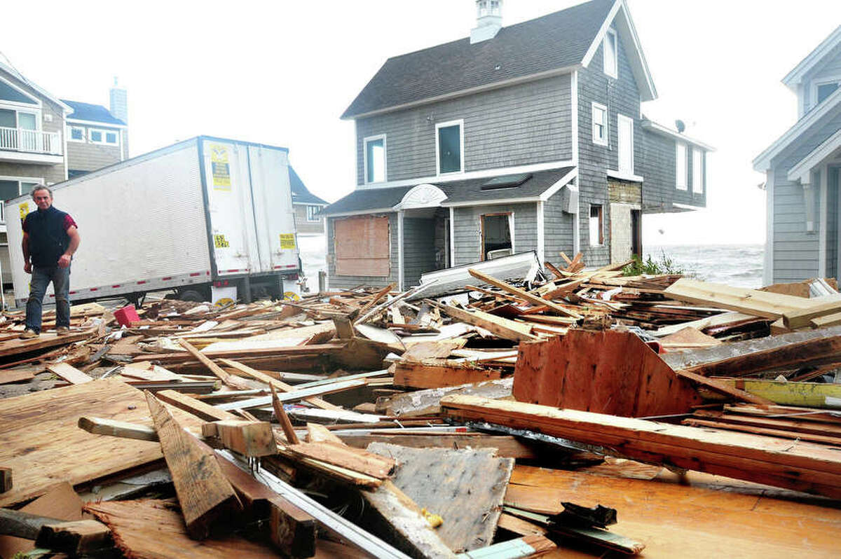 Debris from the previous night's high tide lies behind homes along the shoreline off of Broadway in Milford on 10/30/2012. Photo by Arnold Gold/New Haven Register