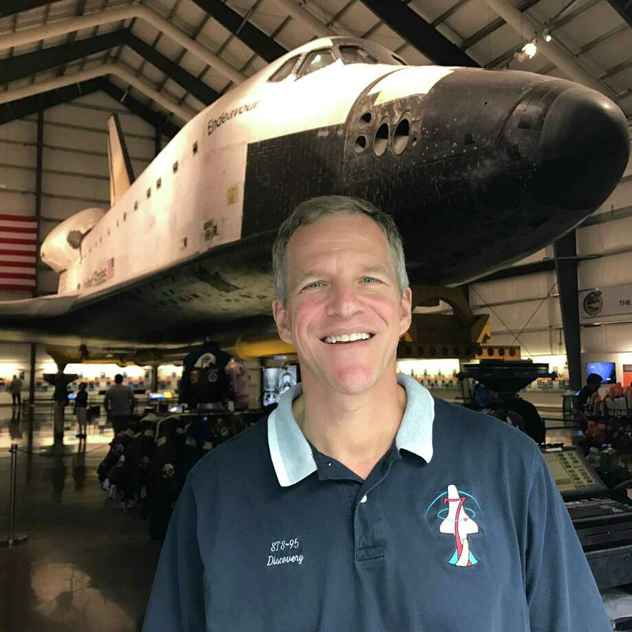 Astronaut Scott Parazynski, standing in front of the Shuttle Endeavor at the California Science Center in Los Angeles, has made five trips to space. Photo: David Hume Kennerly, Contributor / David Hume Kennerly