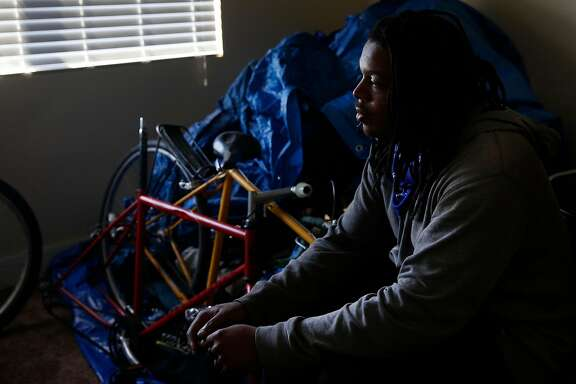 Leedell Omar Thomas pictured in his apartment August 1, 2017 in Richmond, Calif. Thomas was homeless, living in a tent at an encampment on Northgate Avenue in Oakland until he was housed in January. Thomas said the transition has taken some getting used to. He keeps many of his old camping belongings in his living room under a tarp and still visits the camp frequently to see his friends.