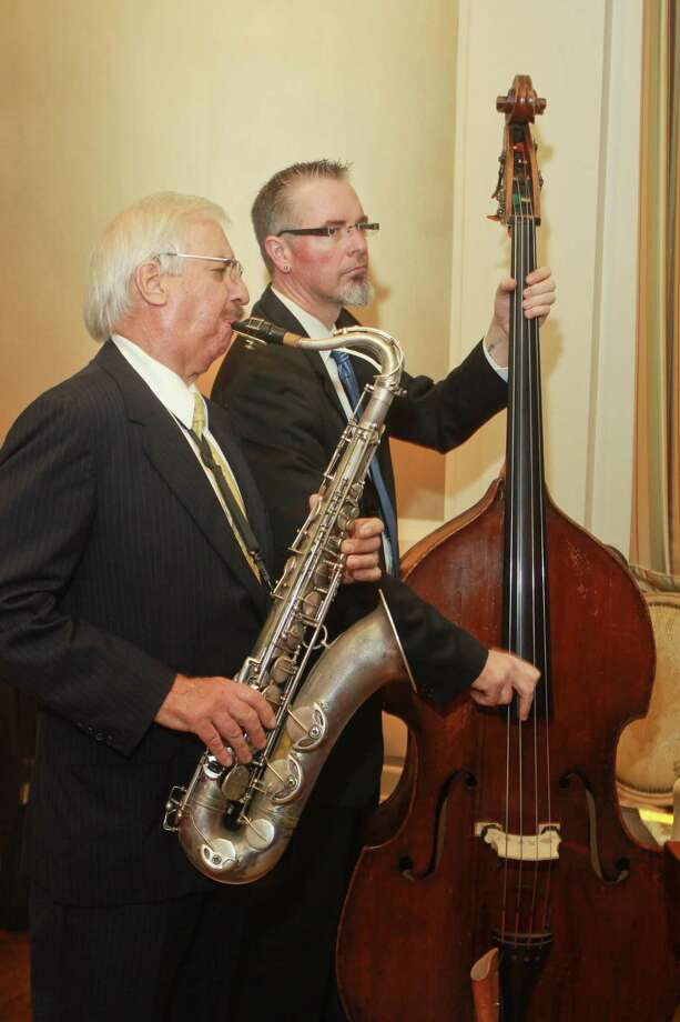 "Larry Slezak, left, playing saxophone, and Thomas Helton played together frequently. Helton called Slezak, who died July 28, a ""mentor and friend."" Photo: Gary Fountain, Freelance / Copyright 2013 Gary Fountain."