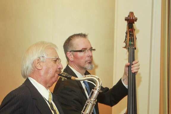 "Larry Slezak, left, playing saxophone, and Thomas Helton played together frequently. Helton called Slezak, who died July 28, a ""mentor and friend."""