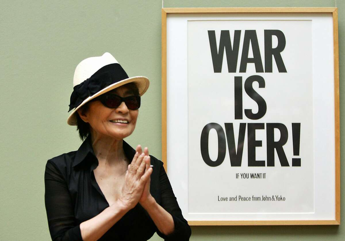 Bremen, GERMANY: Japanese-born artist Yoko Ono, widow of John Lennon, poses 12 June 2007 in Bremen in front of one of her works, during the presentation of her exhibition