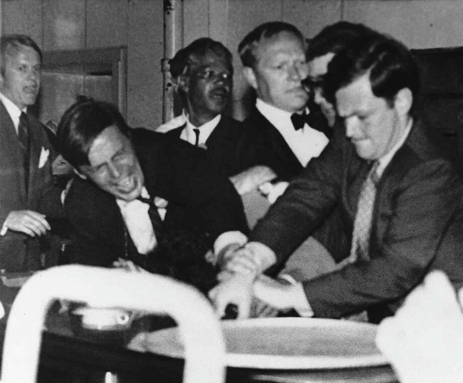 Author George Plimpton, front left, and J.W. Gallivan, Jr., a Robert Kennedy aide, try to wrestle the pistol out of the hand of Sirhan Sirhan, who had just fired the fatal shots at presidential hopeful Sen. Robert Kennedy in the kitchen of the Ambassador Hotel in Los Angeles, June 5, 1968. (AP Photo) No Sales Photo: Uncredited, ASSOCIATED PRESS / AP1968