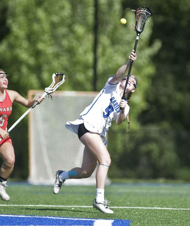 Darien High School's Logan Book tries to catch a pass in the Class L girls lacrosse game against Conard High School, played at Darien on June 1. Photo: Scott Mullin / For Hearst Connecticut Media / The News-Times Freelance