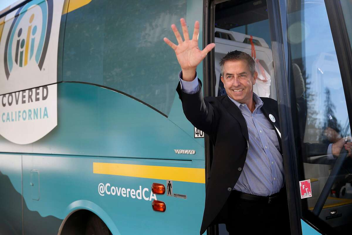 Peter Lee, executive director of Covered California, boards a tour bus after a stop at Kaiser Permanente Medical Center in Oakland. Nearly 36,000 Californians receive health insurance through Covered California's small business exchange, where companies with 100 or fewer employees can purchase health plans for their workers.