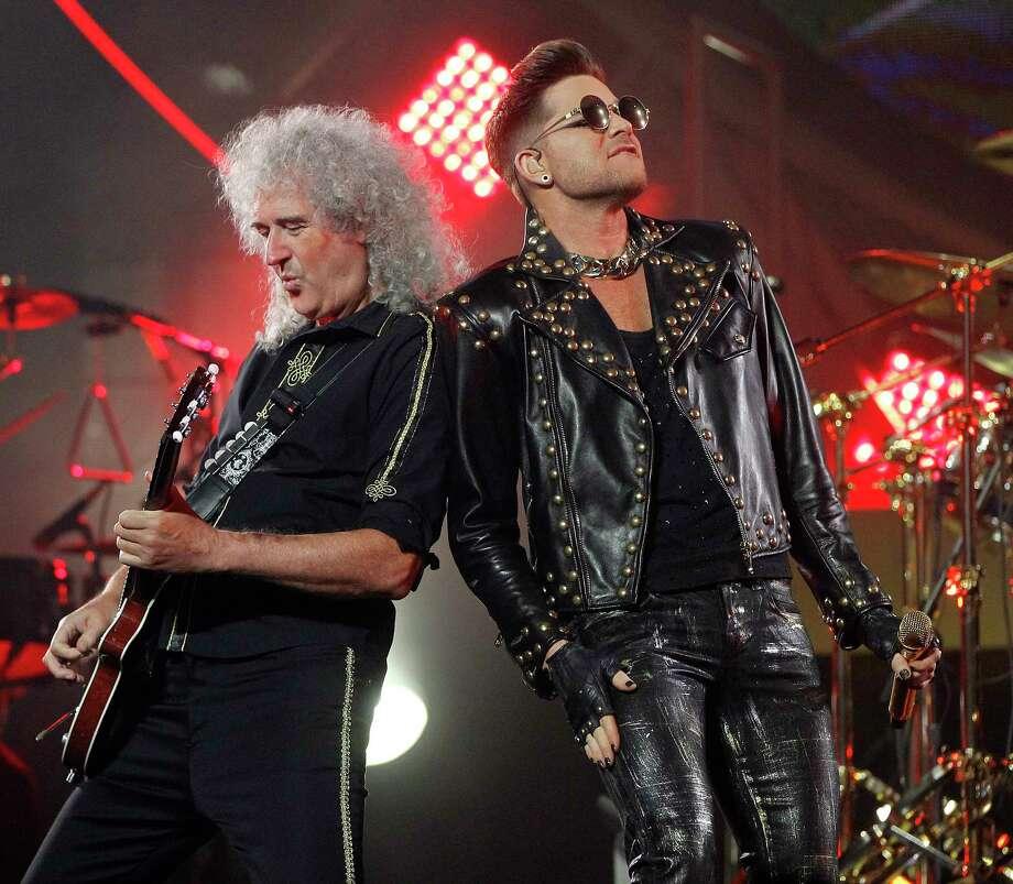 Guitarist Brian May stands next to Adam Lambert as Queen performs at the Toyota Center, Wednesday, July 9, 2014, in Houston.  ( Karen Warren / Houston Chronicle  ) Photo: Karen Warren, Staff / © 2014 Houston Chronicle