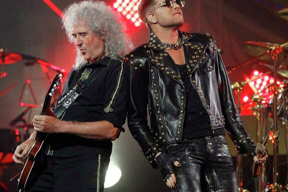 Guitarist Brian May stands next to Adam Lambert as Queen performs at the Toyota Center, Wednesday, July 9, 2014, in Houston.  ( Karen Warren / Houston Chronicle  )