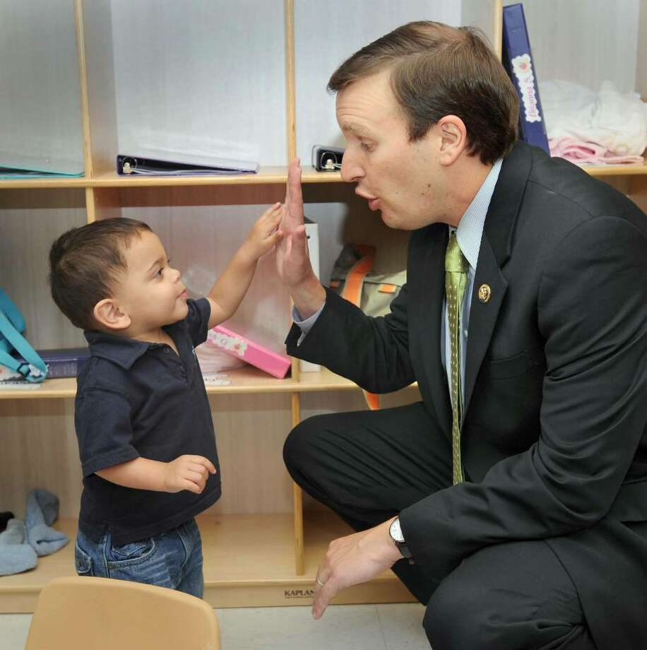 Congressman Chris Murphy high fives Joshuah Dota, 19-months-old, at the Early Head Start program at Mill Ridge Intermediate School in Danbury Monday. Murphy and other officials were on hand Monday morning for the opening celebration of the Early Head Start Program in Danbury, Monday, June 14, 2010. Photo: Carol Kaliff / The News-Times