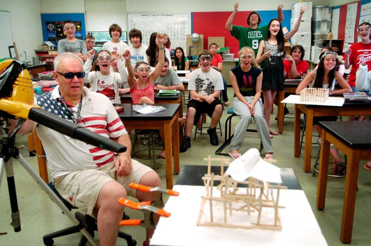 Sal Buchetto, a science teacher at Cloonan Middle School, has had his students construct model houses to see how long they can withstand a 75 and 120 mph winds on Monday June 14, 2010 in Stamford, Conn.