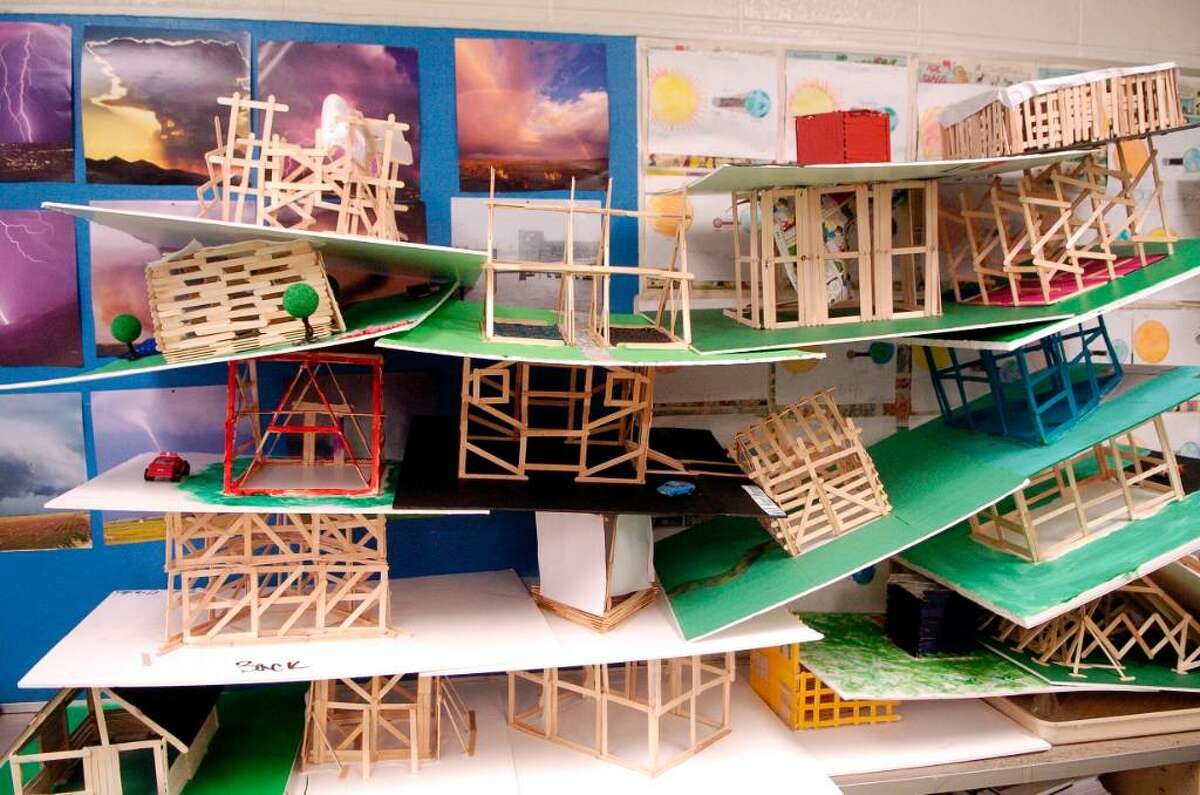 Sal Buchetto, a science teacher at Cloonan Middle School, has had his students construct model houses to see how long they can withstand a 75 and 120 mph wind on Monday June 14, 2010 in Stamford, Conn., none of the houses collapsed