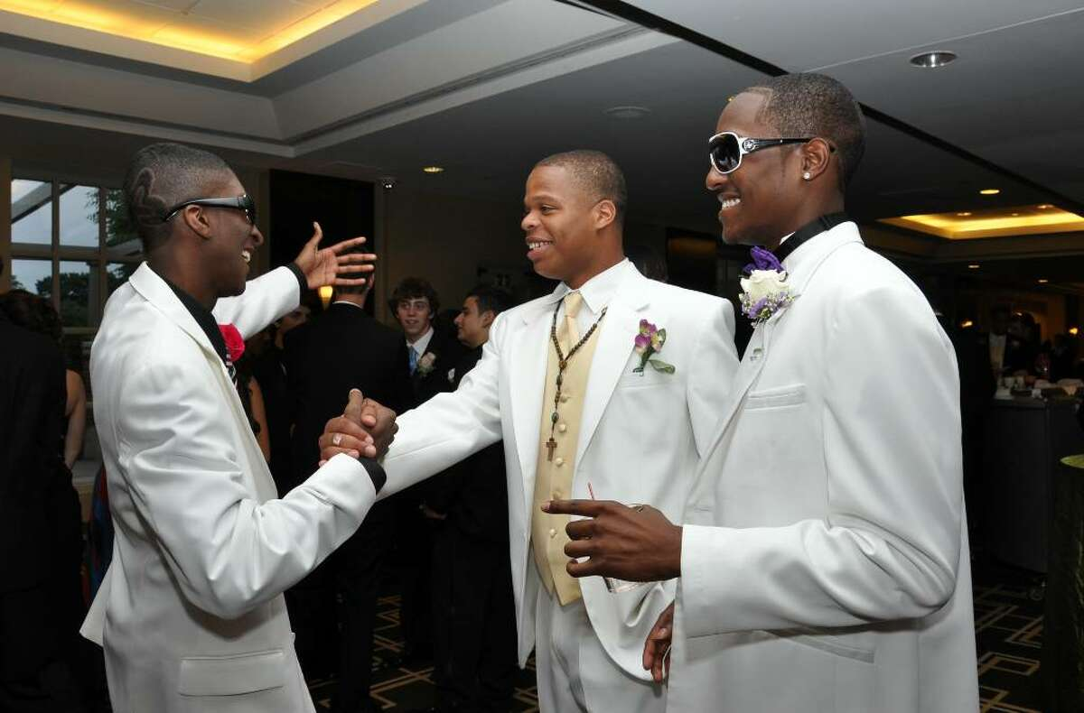 Stamford High School seniors Tyrell Taylor, Kyle Knight and Kevin Parker greet each other before the prom at the Greenwich Hyatt on Friday, June 4, 2010.